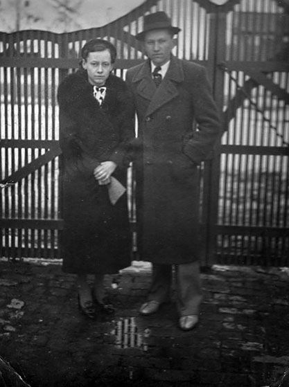 Katharina Lambert & her brother Peter Lambert at the front gate of their Molidorf house 236<br>Click to enlarge